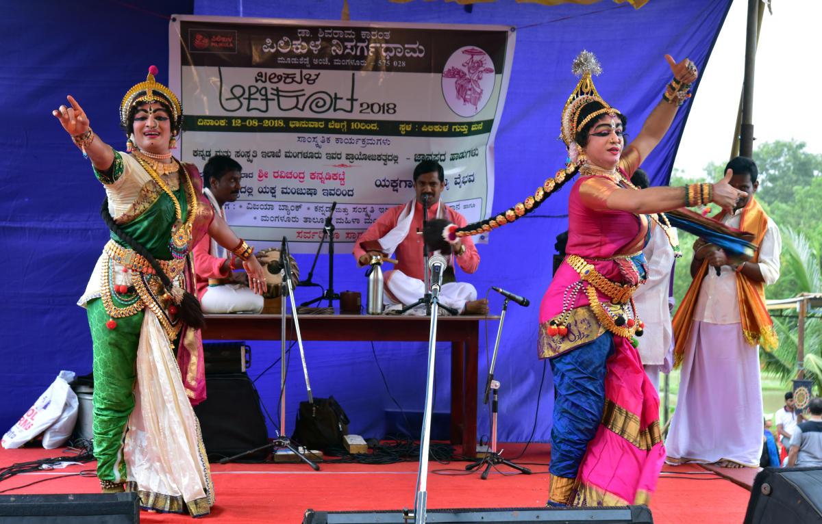 Ravichandra Kannadikatte and troupe perform a Yakshagana dance during the 'Pilikula Atida Koota' organised at the Traditional Guthu House in Dr K Shivaram Karanth Pilikula Nisargadhama on Sunday.