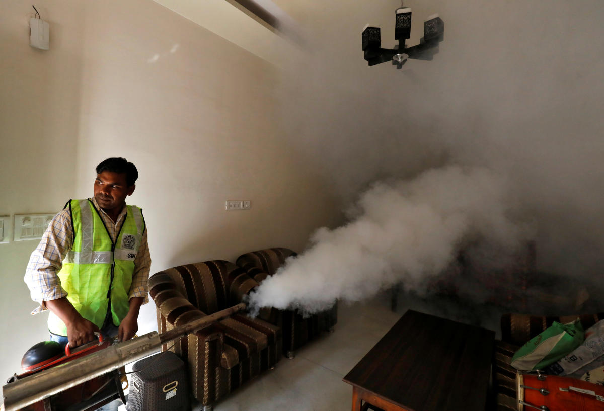 A public health department worker fumigates inside a house to prevent the spread of mosquito borne diseases in New Delhi, India, October 9, 2018. (REUTERS)