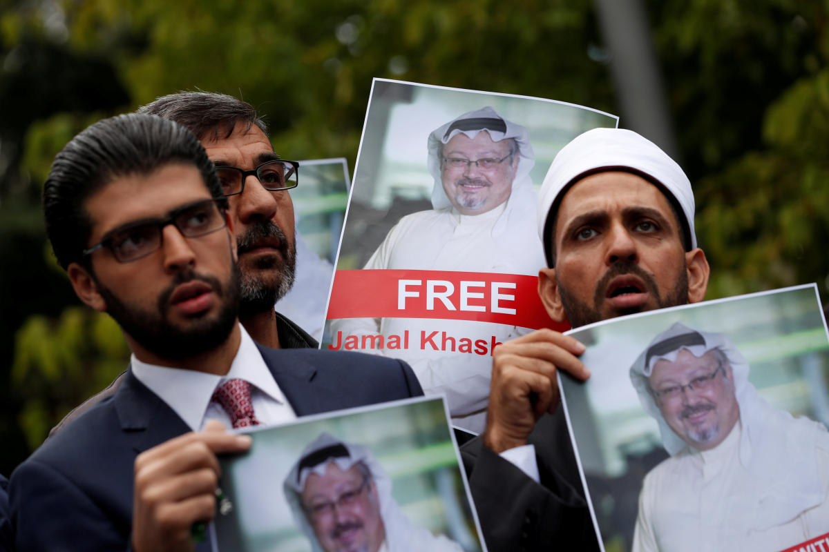 Human rights activists and friends of Saudi journalist Jamal Khashoggi hold his pictures during a protest outside the Saudi Consulate in Istanbul, Turkey October 8, 2018. (Reuters File Photo)