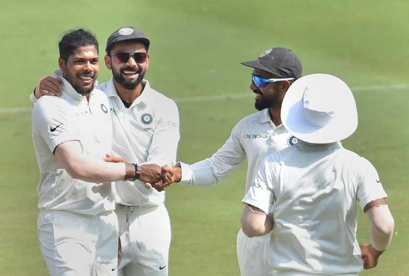 Umesh Yadav celebrates with team-mates the dismissal of West Indian cricketer Shane Dowrich during the third day's play of the second Test cricket match between India and West Indies at the Rajiv Gandhi International Cricket Stadium in Hyderabad. PTI