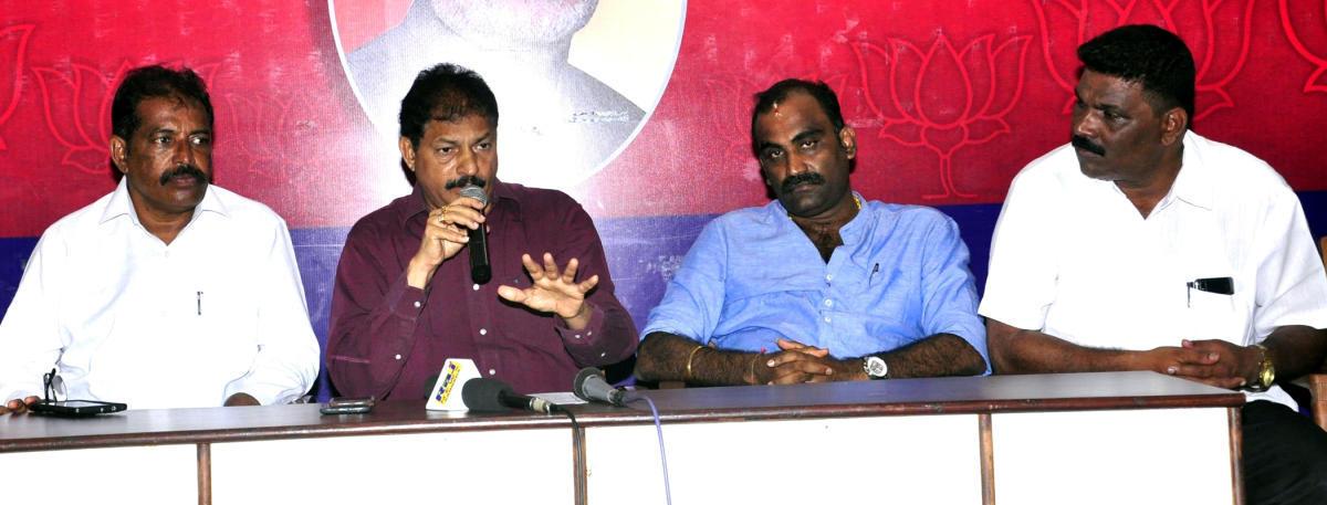 BJP Udupi district president Mattar Ratnakar Hegde speaks to reporters in Udupi on Saturday.