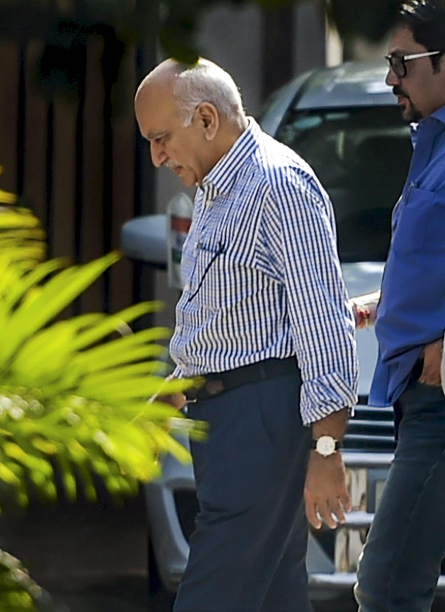 Union minister M J Akbar (L), who is facing allegations of sexual harassment by a number of women journalists, at his residence after his arrival from a foreign tour, in New Delhi, on Sunday. PTI