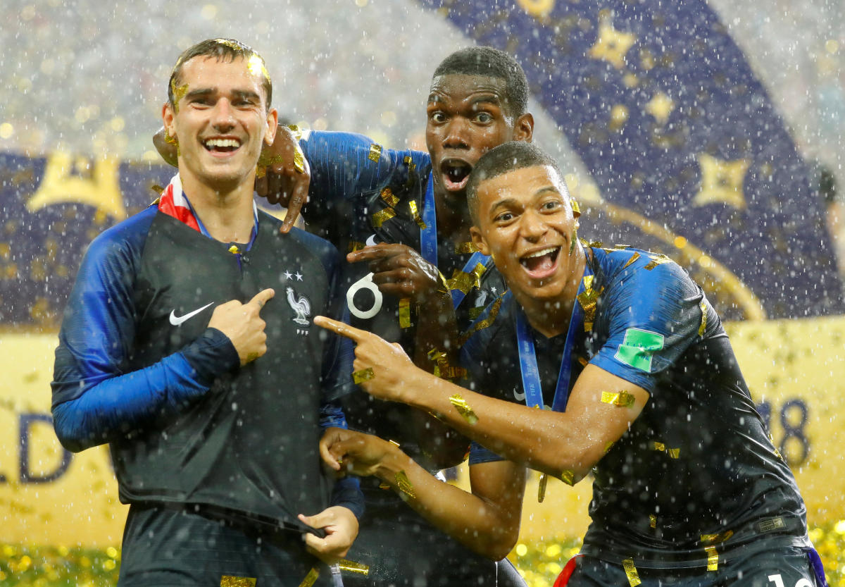France's Antoine Griezmann, Paul Pogba and Kylian Mbappe celebrate after winning the World Cup. REUTERS