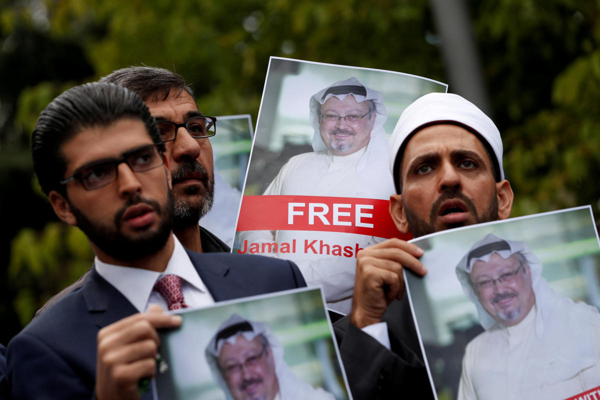 Human rights activists and friends of Saudi journalist Jamal Khashoggi hold his pictures during a protest outside the Saudi Consulate in Istanbul, Turkey October 8, 2018. (REUTERS/Murad Sezer/File Photo)