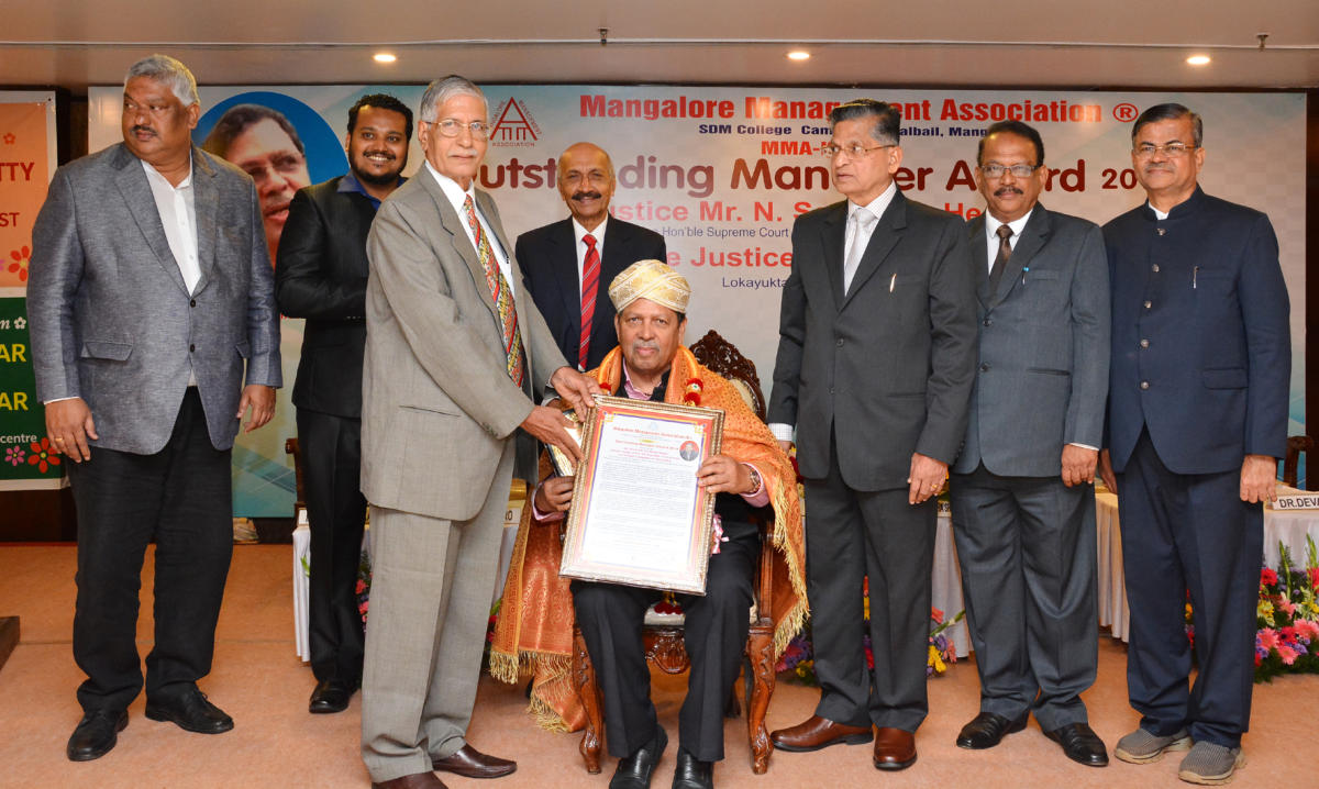 Former Lokayukta Justice Santosh Hegde is conferred 'Outstanding Manager Award,' instituted by Mangalore Management Association in Mangaluru recently.
