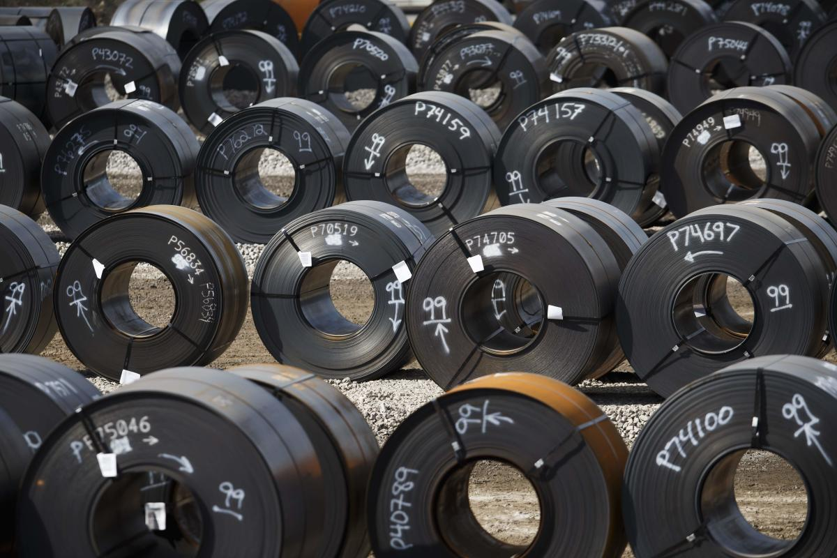 In this file photo taken on June 4, 2018, steel coils lay in a yard at ArcelorMittal Dofasco steel plant in Hamilton, Canada.