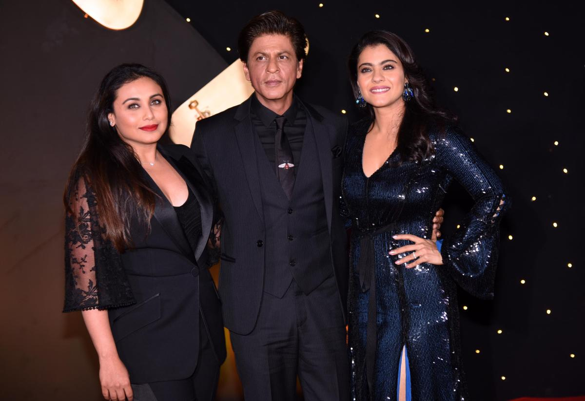 """Indian Bollywood actors Rani Mukharjee, Shah Rukh Khan and Kajol Devgan pose for a picture as they attend an event celebrating the 20th anniversary of the Hindi film """"Kuch Kuch Hota Hai"""", in Mumbai on October 16, 2018. (AFP File Photo)"""