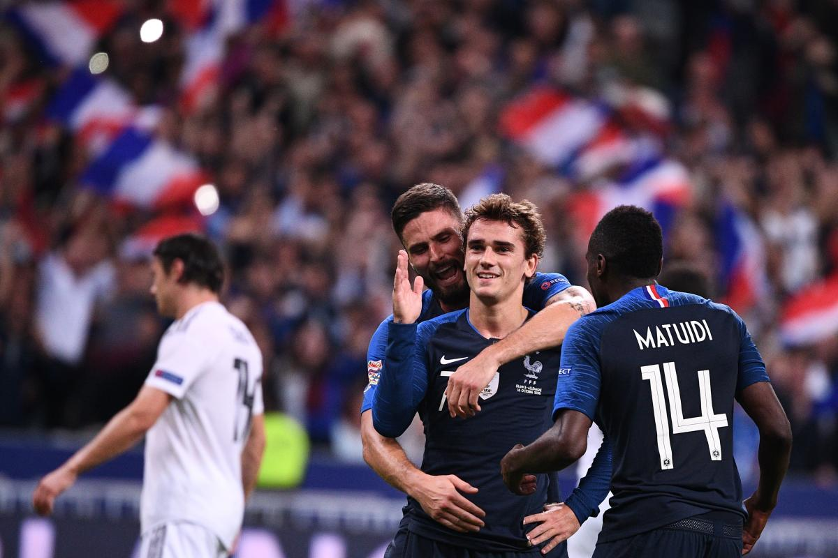 DELIGHTED: France's Antoine Griezmann (centre) is congratulated by Olivier Giroud (behind) and Blaise Matuidi after he scored the team's second goal. AFP