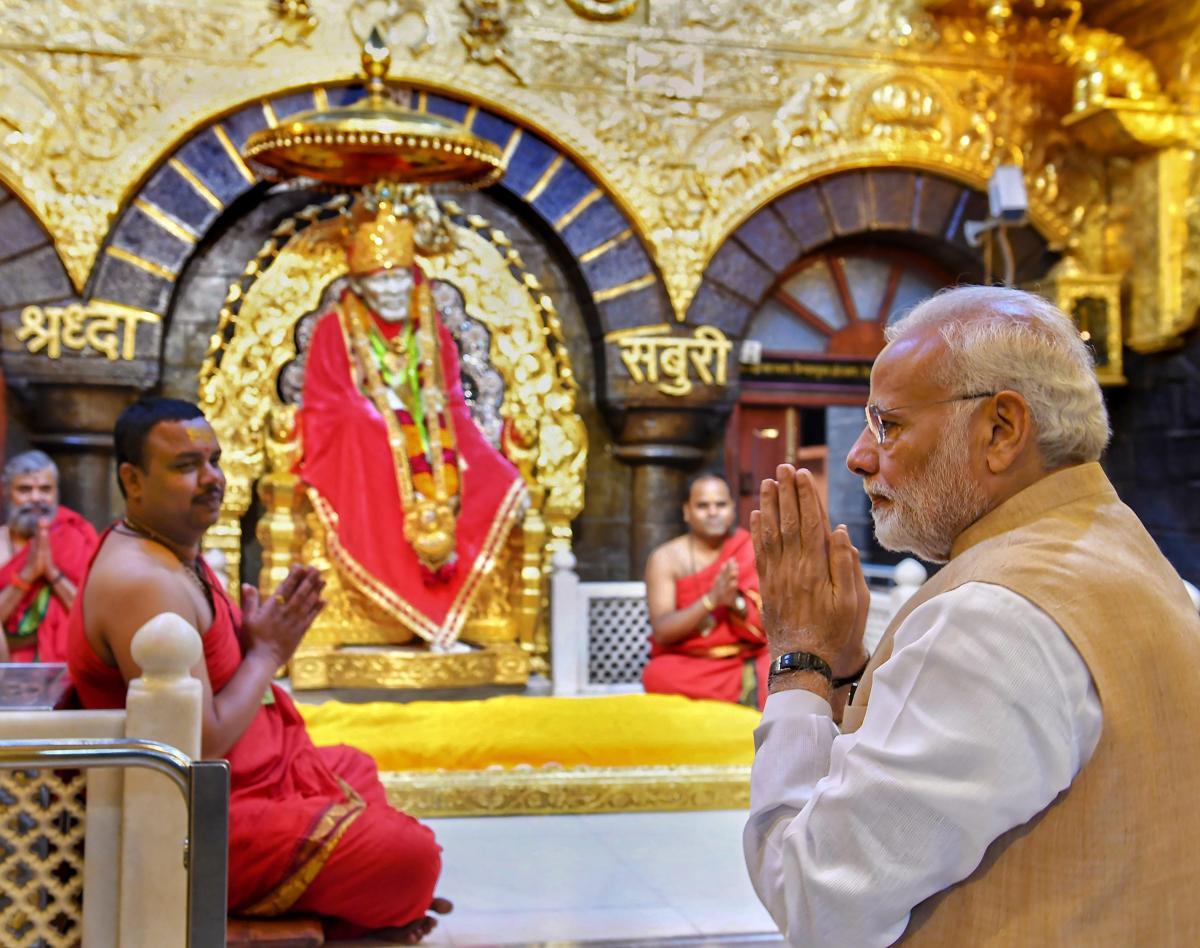 Prime Minister Narendra Modi offers prayers at Shri Sai Baba Temple in Shirdi, Maharashtra. (PTI photo)