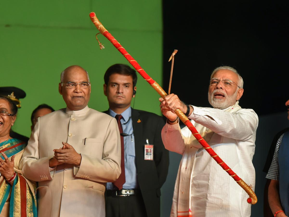 Prime Minister Narendra Modi releases the arrow with a bow to symbolically set on fire the effigy of evil king Ravana during Dussehra celebrations of Luv Kush Ramleela Committee at Red Fort ground in New Delhi, Friday on Friday. PTI photo