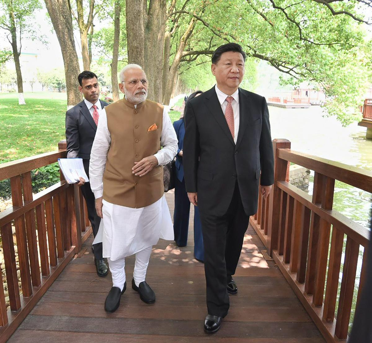 Prime Minister Narendra Modi with Chinese President Xi Jinping take a walk together along the East Lake, in Wuhan, China. PTI