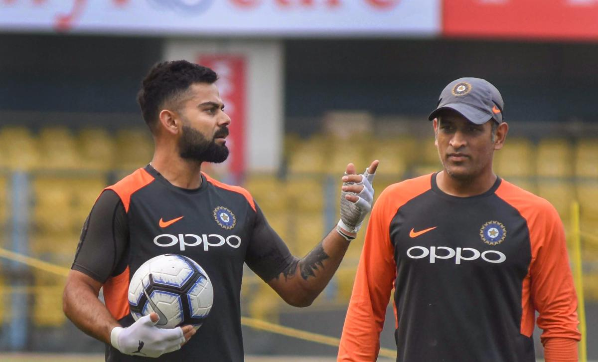 Indian captain Virat Kohli (left) with M S Dhoni on the eve of the first ODI against the West Indies in Guwahati on Saturday. PTI