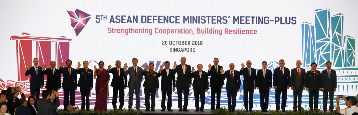 Defence Ministers pose for group photo at ASEAN defence ministers meeting in Singapore. Reuters photo