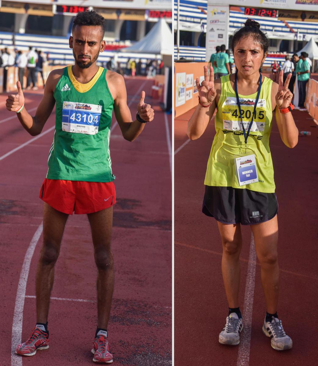 VICTORIOUS Ethiopia's Mikiyas Yemata (left) and Aneeta Chaudhary of India won the men's and women's titles respectively in the Bengaluru Marathon at the Sree Kanteerava Stadium on Sunday. DH Photo/ S K Dinesh
