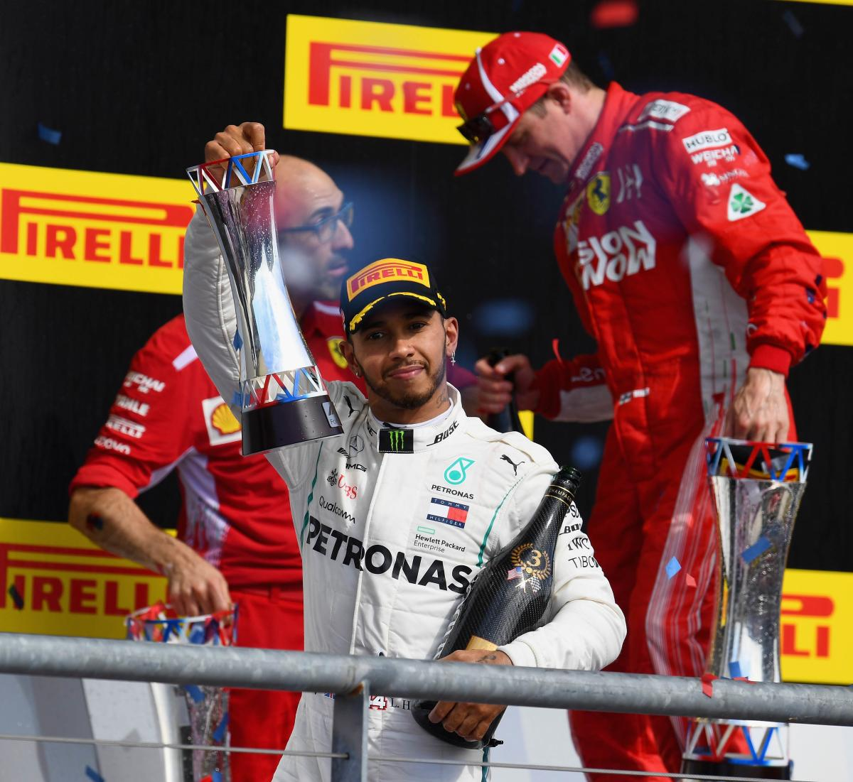 Third placed Lewis Hamilton of Mercedes celebrates on the podium after the United States Grand Prix. AFP