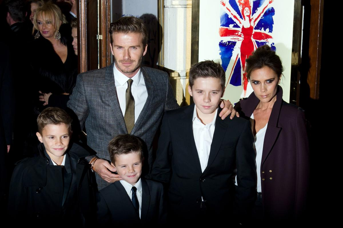 David and Victoria Beckham pose on the red carpet with three of their children in London on December 11, 2012. AFP File