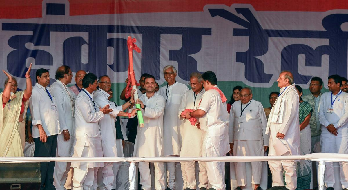 Congress president Rahul Gandhi being presented the model of a plough during the Kisan Hunkar Rally in Raipur, Chhattisgarh, on October 22. PTI