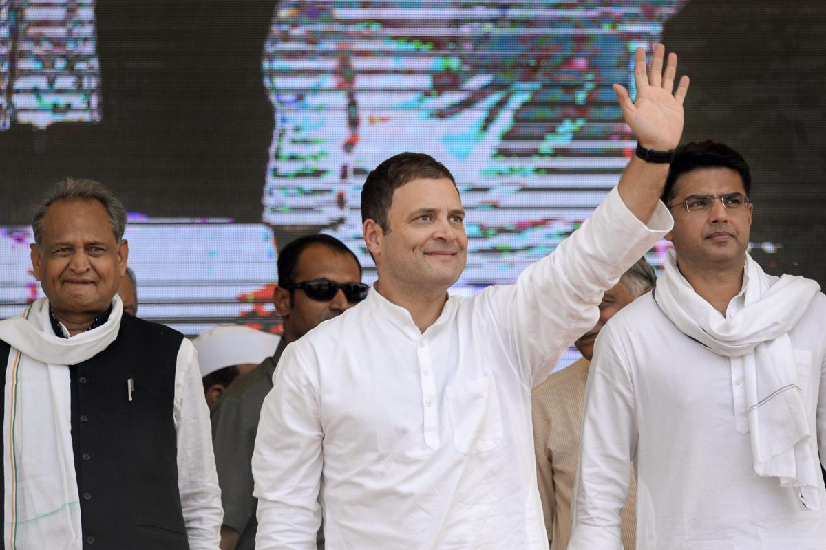 Congress President Rahul Gandhi waves at crowd during a public meeting in Jhalawar, Rajasthan, on Wednesday. RPCC President Sachin Pilot and former chief minister Ashok Gehlot are also seen. PTI