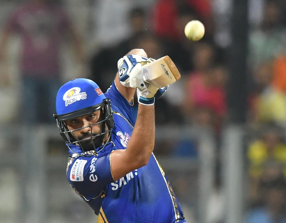 Mumbai Indians captain Rohit Sharma plays a shot during the 2018 Indian Premier League (IPL) Twenty20 cricket match between Mumbai Indians and Royal Challengers Bangalore at the Wankhede stadium in Mumbai on April 17, 2018. AFP
