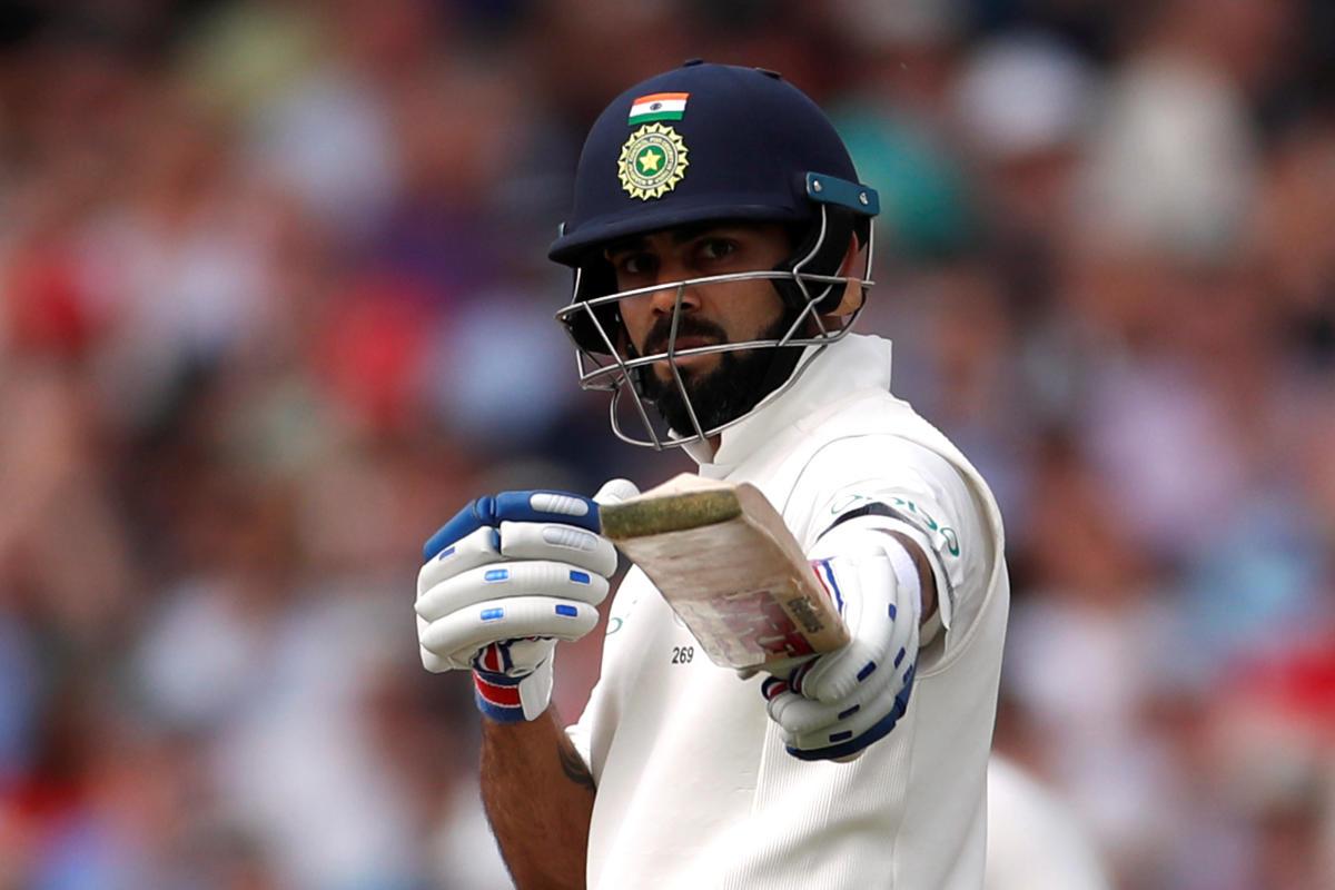 India's Virat Kohli celebrates after scoring a half-century against England on Saturday. Reuters