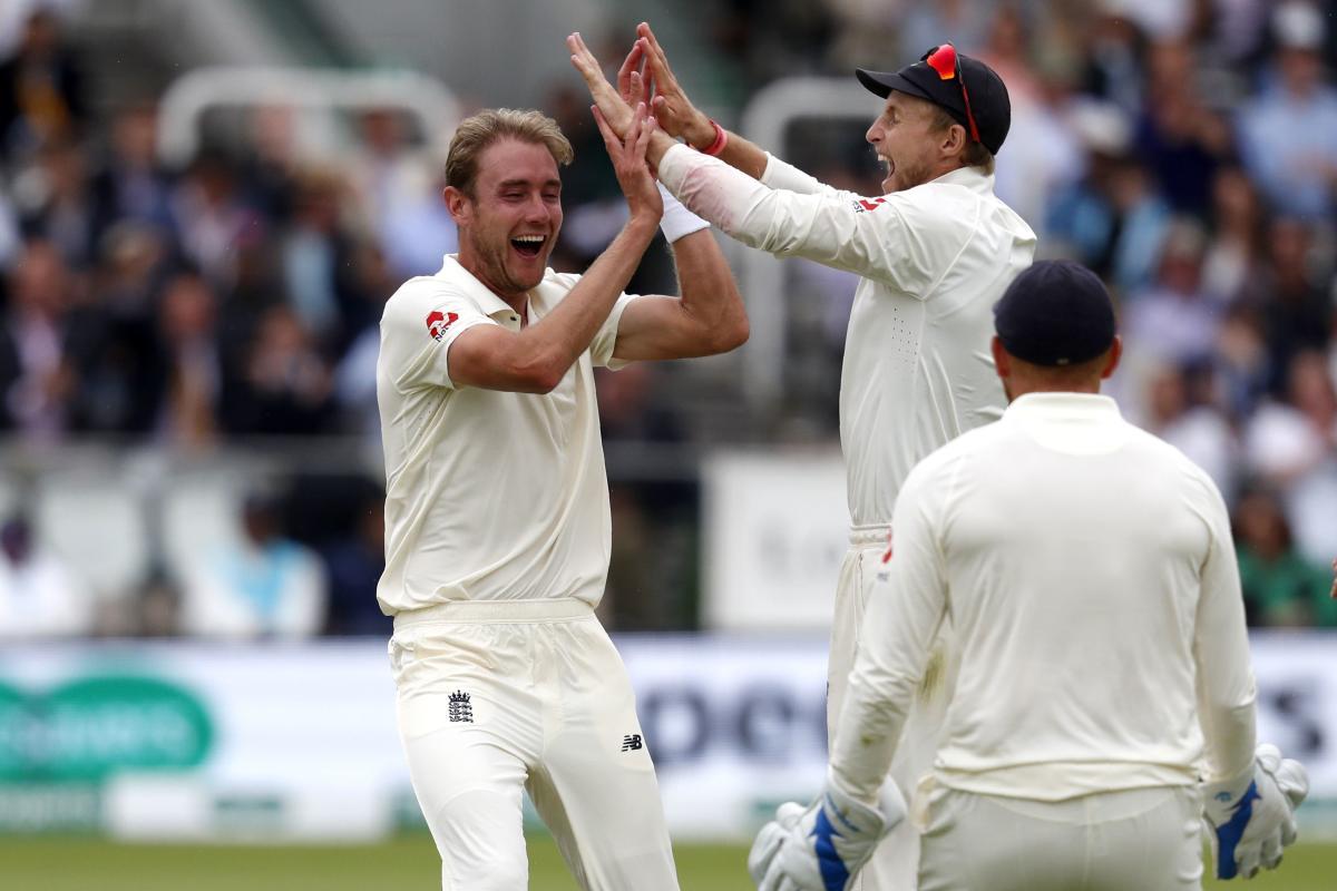 England's Stuart Broad (left) celebrates with skipper Joe Root after dismissing Dinesh Karthik on Sunday. AFP