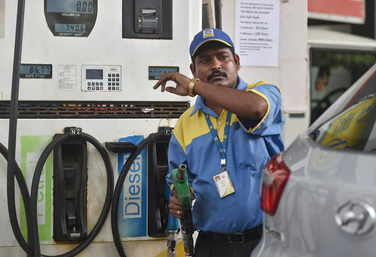 COSTLY FILL: An employee points towards the revised prices of petrol and diesel at a fuel station in Mumbai. PTI