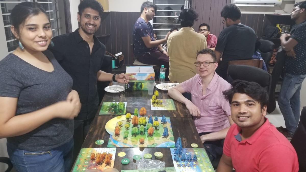 People play board games during a weekly meet-up.