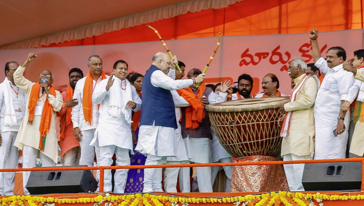 BJP president Amit Shah beats a drum as the party begins its campaign in the poll-bound state, in Hyderabad, on Saturday. PTI