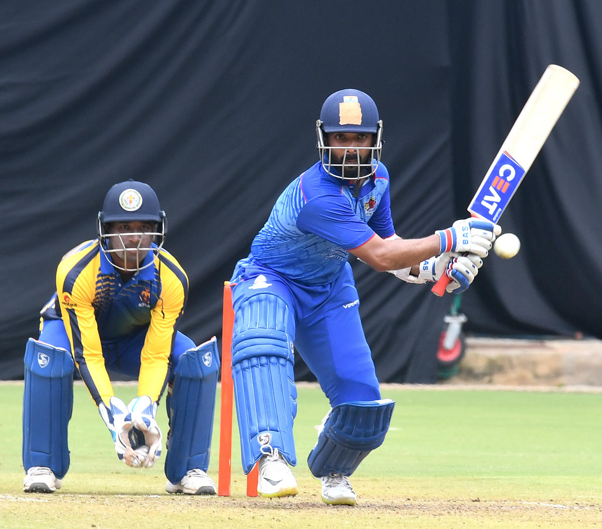 Mumbai's Ajinkya Rahane plays a reverse hit during his century against Karnataka in the Vijay Hazare Trophy at the Chinnaswamy stadium in Bengaluru on Friday. DH Photo/ Srikanta Sharma R