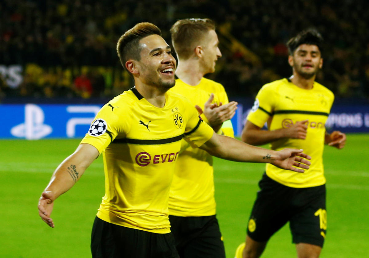NIGHT TO SAVOUR: Borussia Dortmund's Raphael Guerreiro (left) celebrates after against Atletico Madrid during their Champions League game on Wednesday. REUTERS