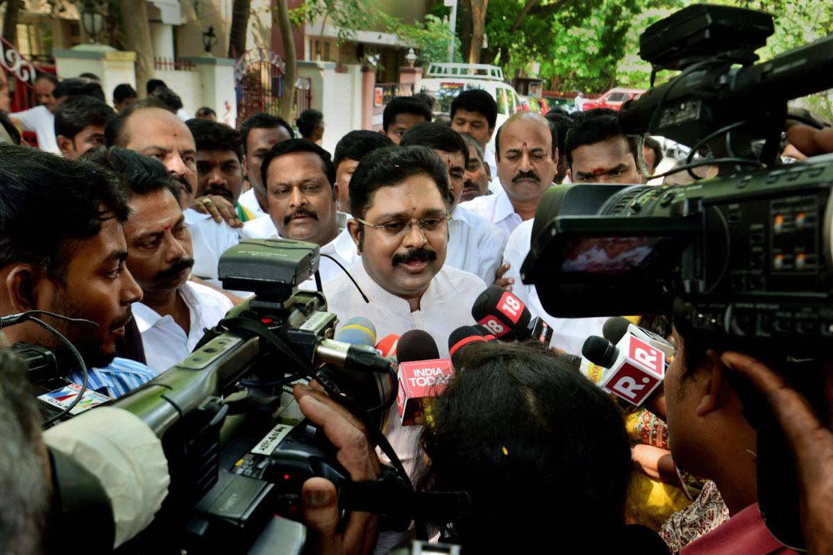 Amma Makkal Munetra Kazhagam chief TTV Dhinakaran reacts before the media on Madras High Court's verdict disqualifying 18 rebel MLAs of the ruling AIADMK, in Chennai, on Thursday. PTI
