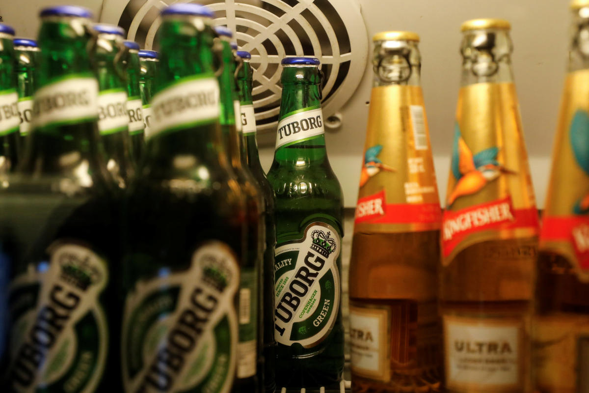 Bottles of Kingfisher and Tuborg beer are displayed in a fridge at a pub in Mumbai, India. Reuters