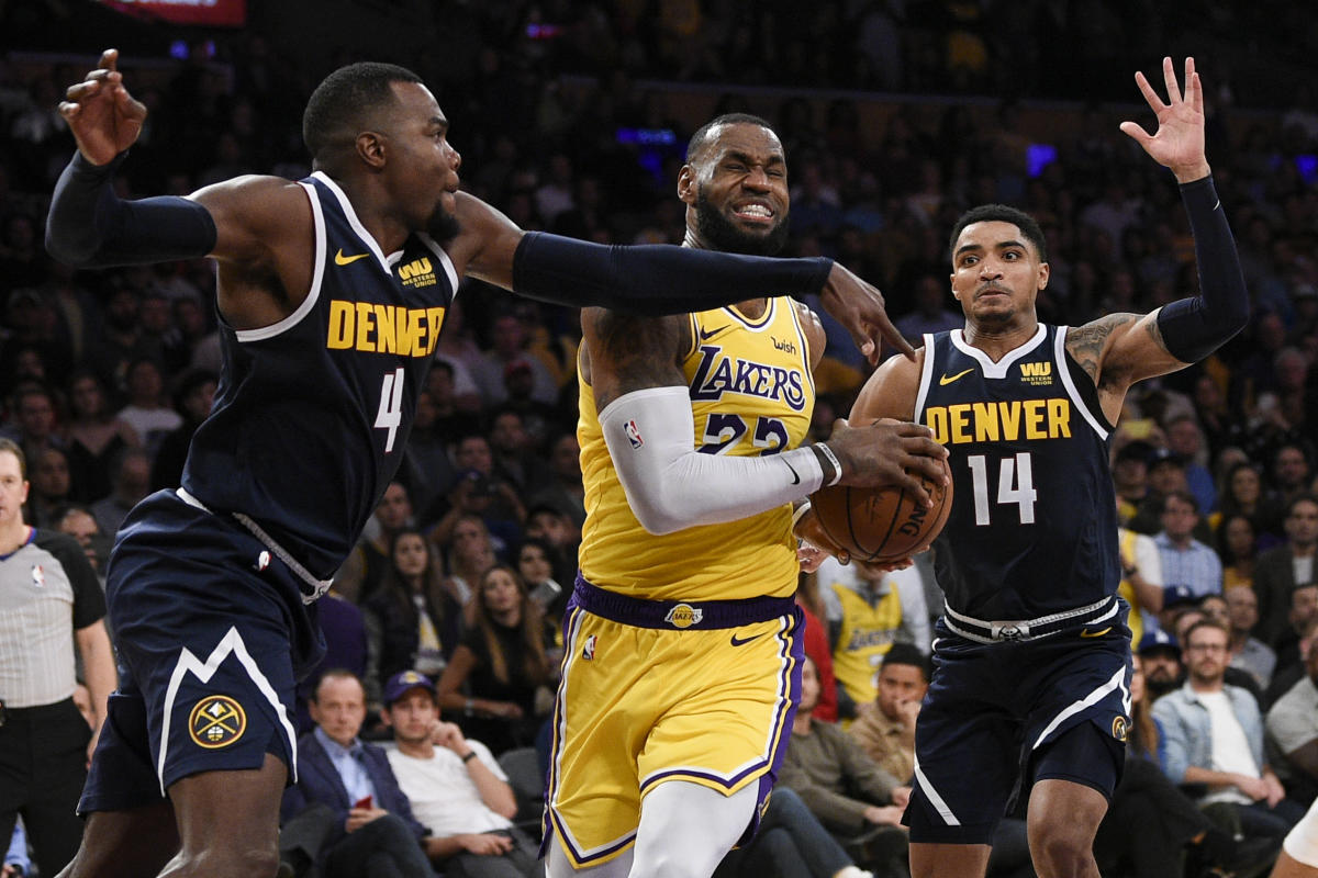 Los Angeles Lakers forward LeBron James (23) attempts to drive the ball past Denver Nuggets forward Paul Millsap (4) during the second half at Staples Center. USA TODAY Sports