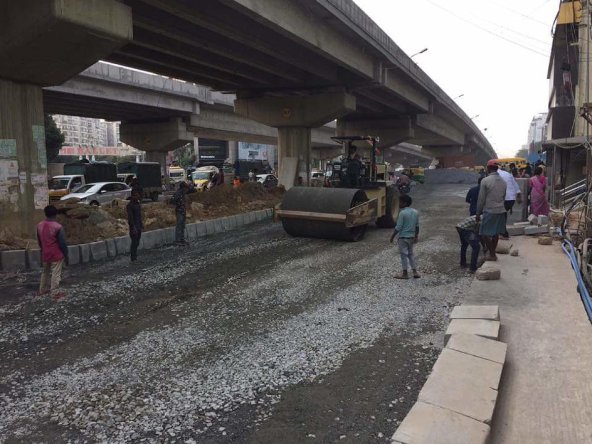 The much-awaited asphalting of a road under the Doddanekkundi flyover began on Wednesday.
