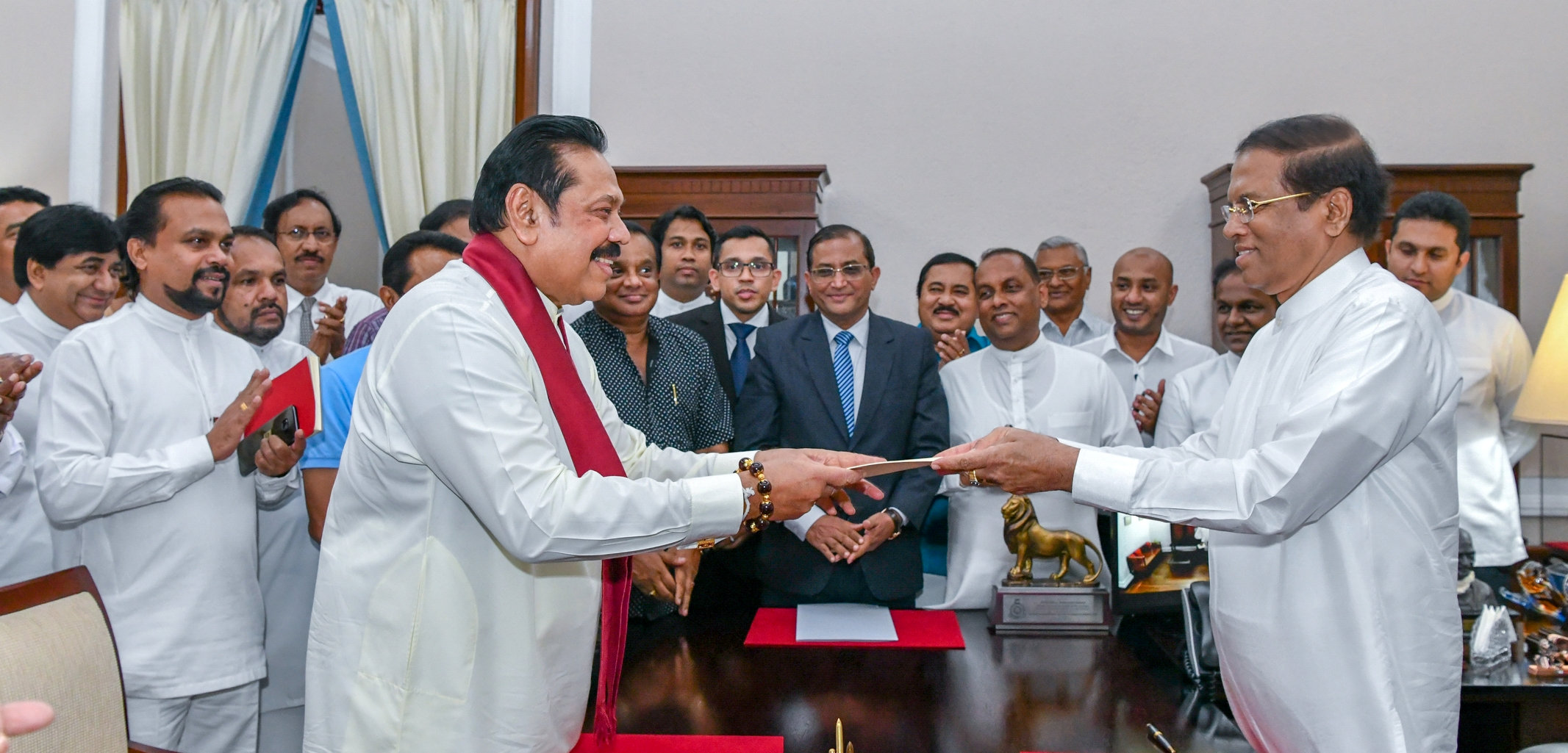 Sri Lanka's former President Mahinda Rajapaksa (Front-L) is sworn in as the new Prime Minister before President Maithripala Sirisena in Colombo on Friday. Reuters
