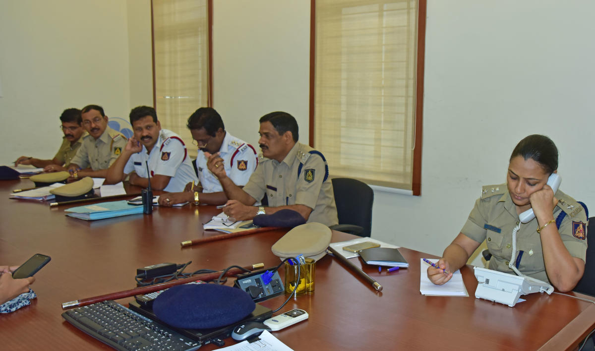 DCP (Crime and Traffic) Uma Prashanth responds to a telephone call during the phone-in programme organised by Mangaluru Police Commissionerate on Friday.