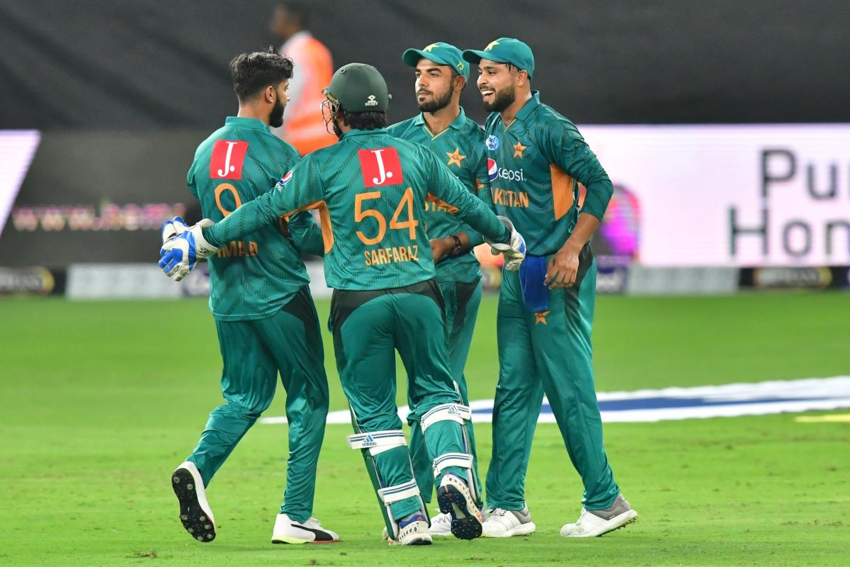 JOYOUS: Pakistan's Shadab Khan (centre) celebrates after dismissing Australia's Chris Lynn during the second T20 match. AFP