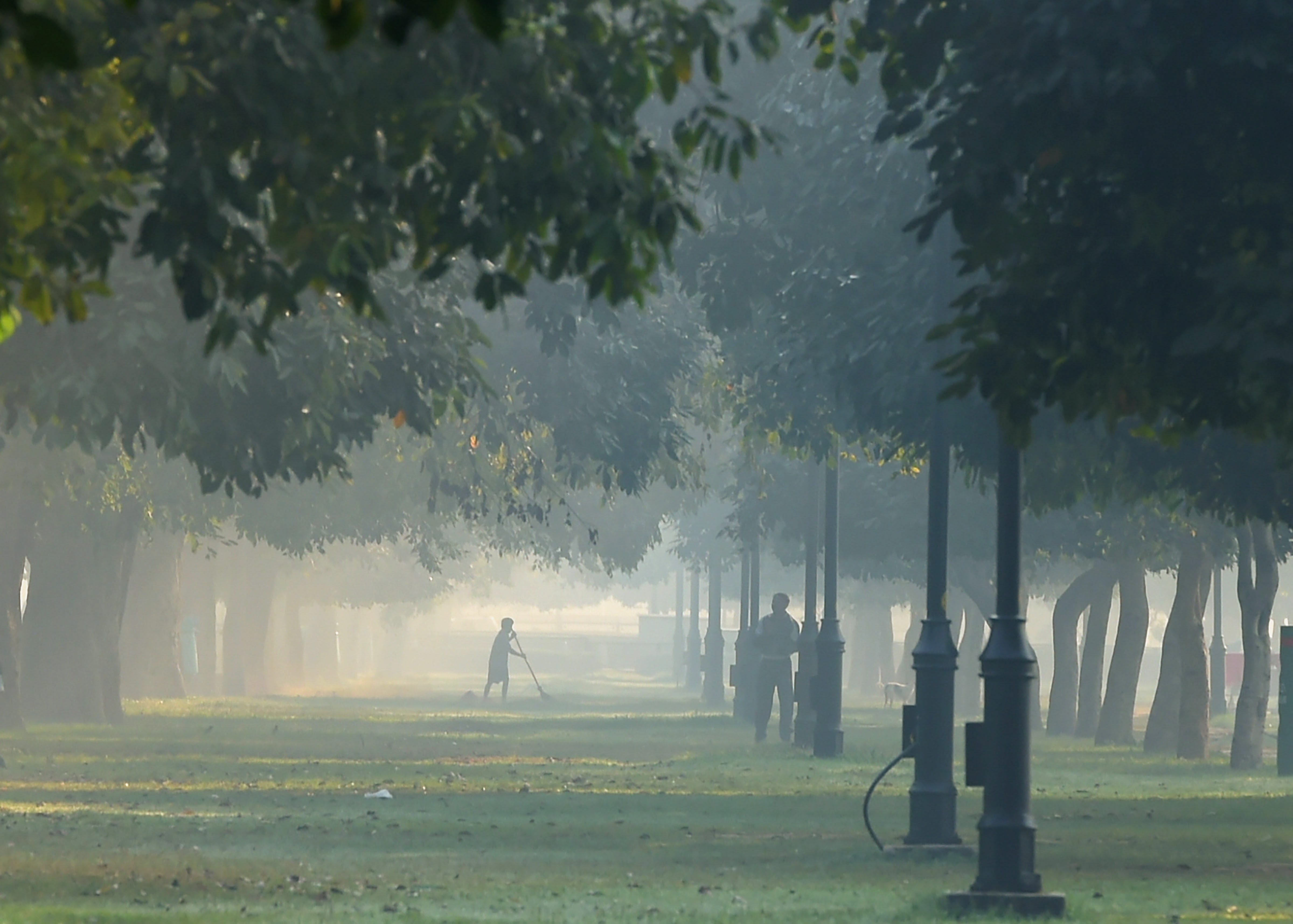 A view of Rajpath lawns engulfed in smog, in New Delhi, on Friday. The national capital is engulfed in haze and deadly air pollution with the onset of winters and festival season. PTI