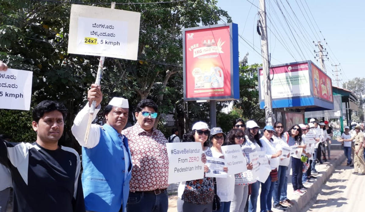 The residents of Bellandur formed human chain demanding better infrastructure facilities from BBMP on Saturday.