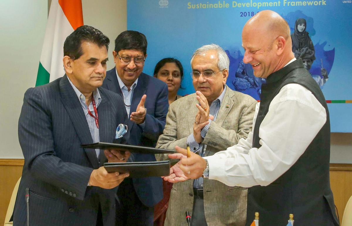 UN: NITI Aayog CEO Amitabh Kant (L) exchange documents with United Nations Resident Coordinator in India Yuri Afanasiev (R) after signing Sustainable Development Framework for 2018-2022, in UN, Friday, Sept 28, 2018. Also seen are as Joint Secretary Vikra