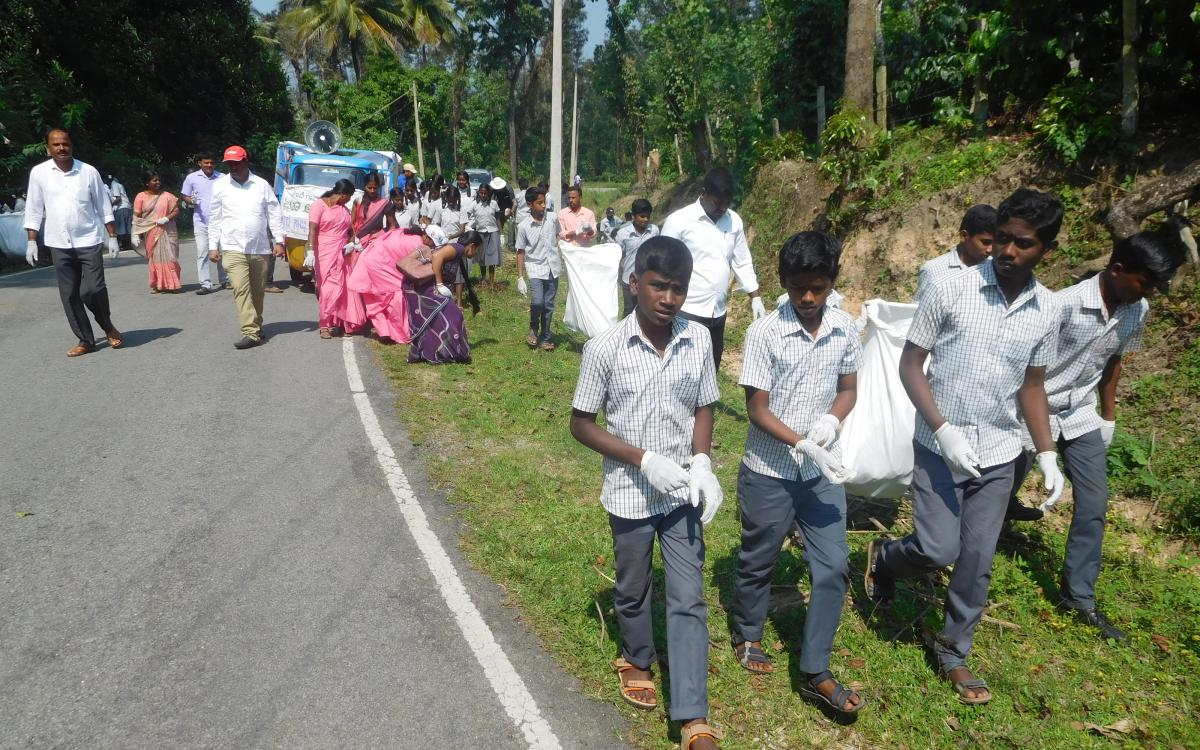 Schoolchildren, Asha workers and other volunteers take part in cleanliness drive at Koove Gram Panchayat in Mudigere.