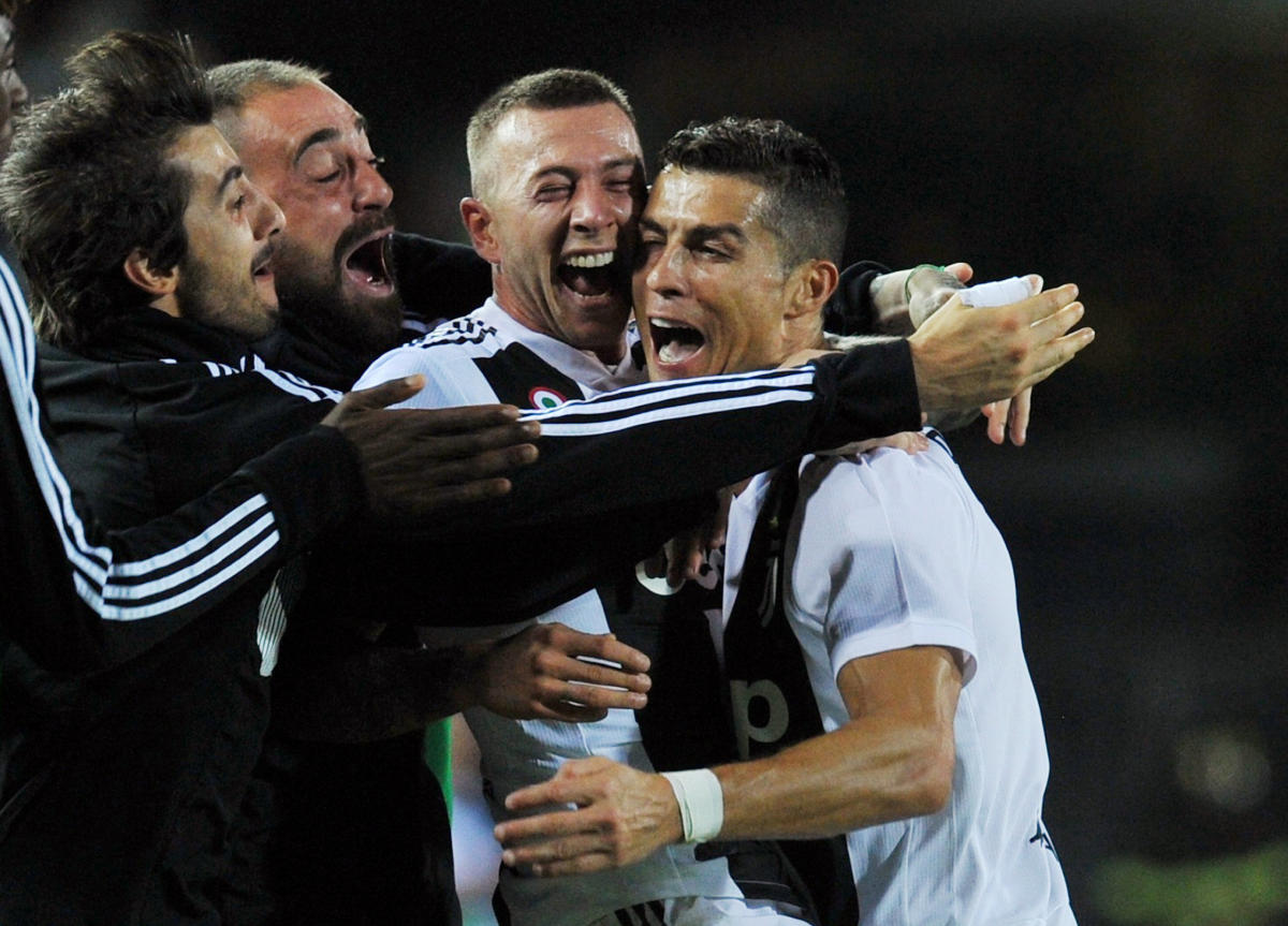 EVER DEPENDABLE: Juventus' Cristiano Ronaldo (right) celebrates with team-mates after scoring the second goal. Reuters