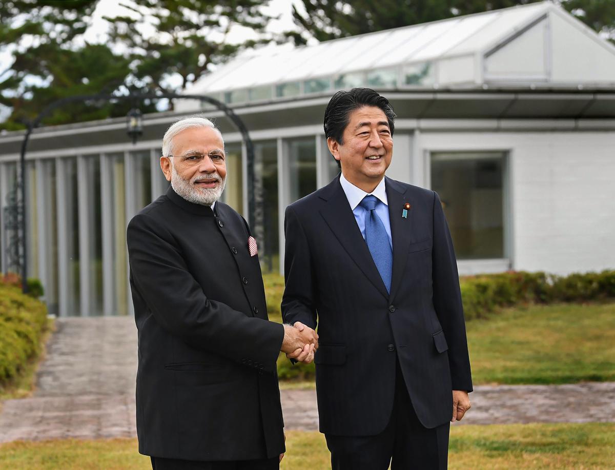 Prime Minister Narendra Modi shakes hands with his Japanese counterpart Shinzo Abe, at Yamanashi, Japan, Sunday, Oct 28, 2018. (PIB Photo via PTI)