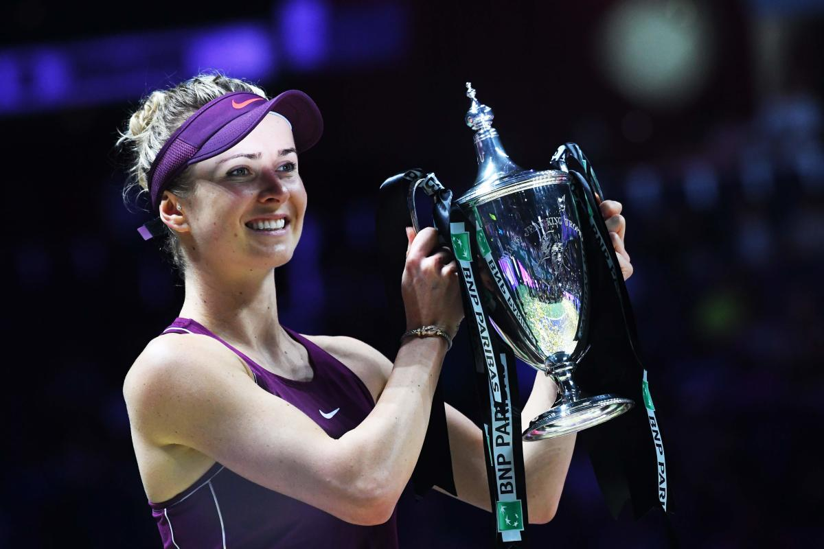PERFECT FINISH Ukraine's Elina Svitolina with the WTA Finals after defeating Sloane Stephens in the final on Sunday. AFP