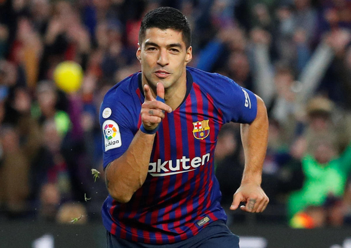 DAZZLING DISPLAY: Barcelona's Luis Suarez celebrates after scoring against Real Madrid during their La Liga clash on Sunday. REUTERS