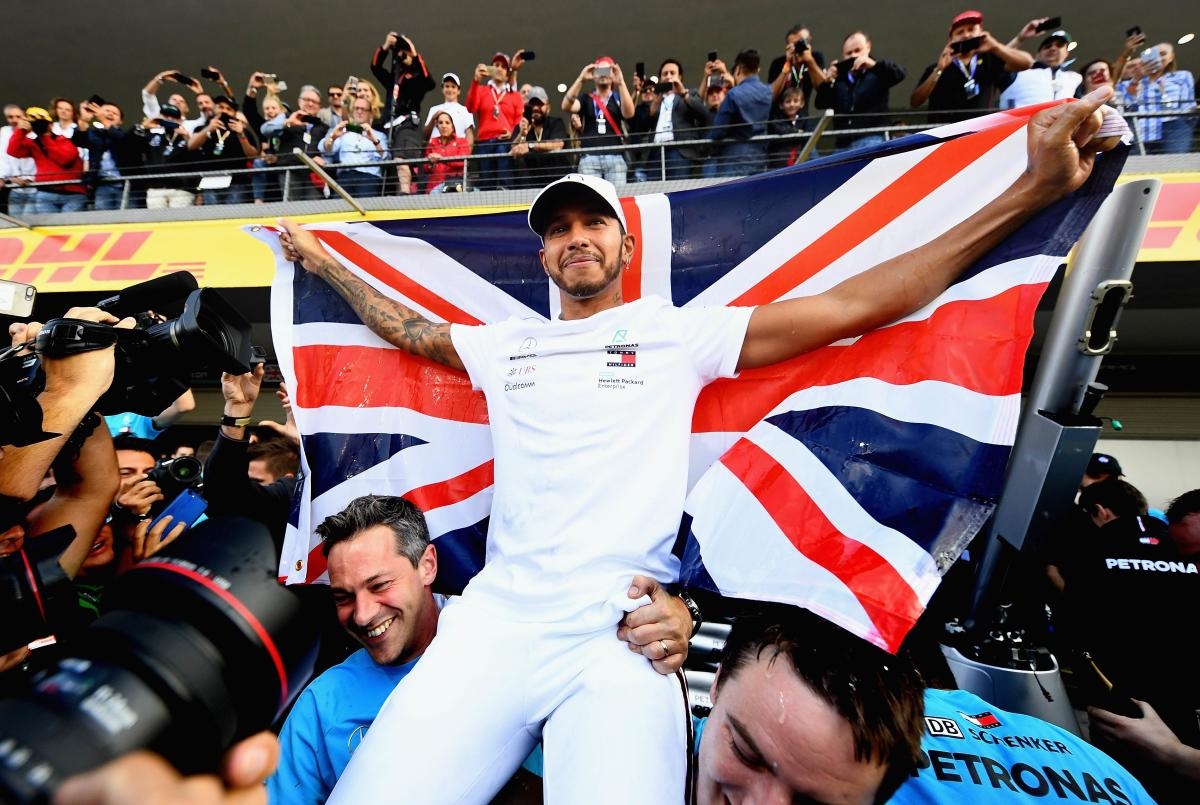 ON TOP OF THE WORLD: Mercedes driver Lewis Hamilton celebrates with team-mates after winning his fifth world championship crown in Mexico City on Sunday. AFP