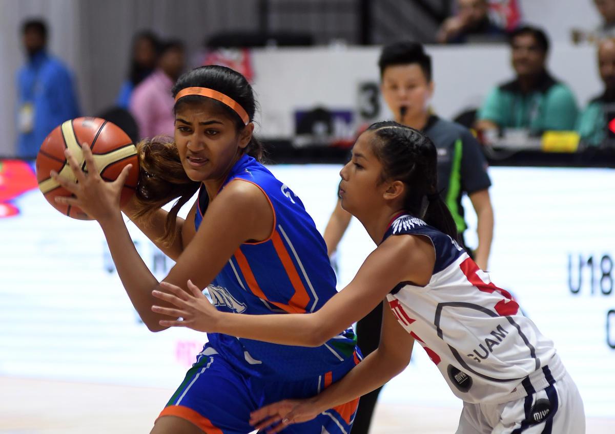 SURGING AHEAD India's Srishti Suren attempts to dribble past Alana Salas of Guam on Monday. DH Photo/ Srikanta Sharma R
