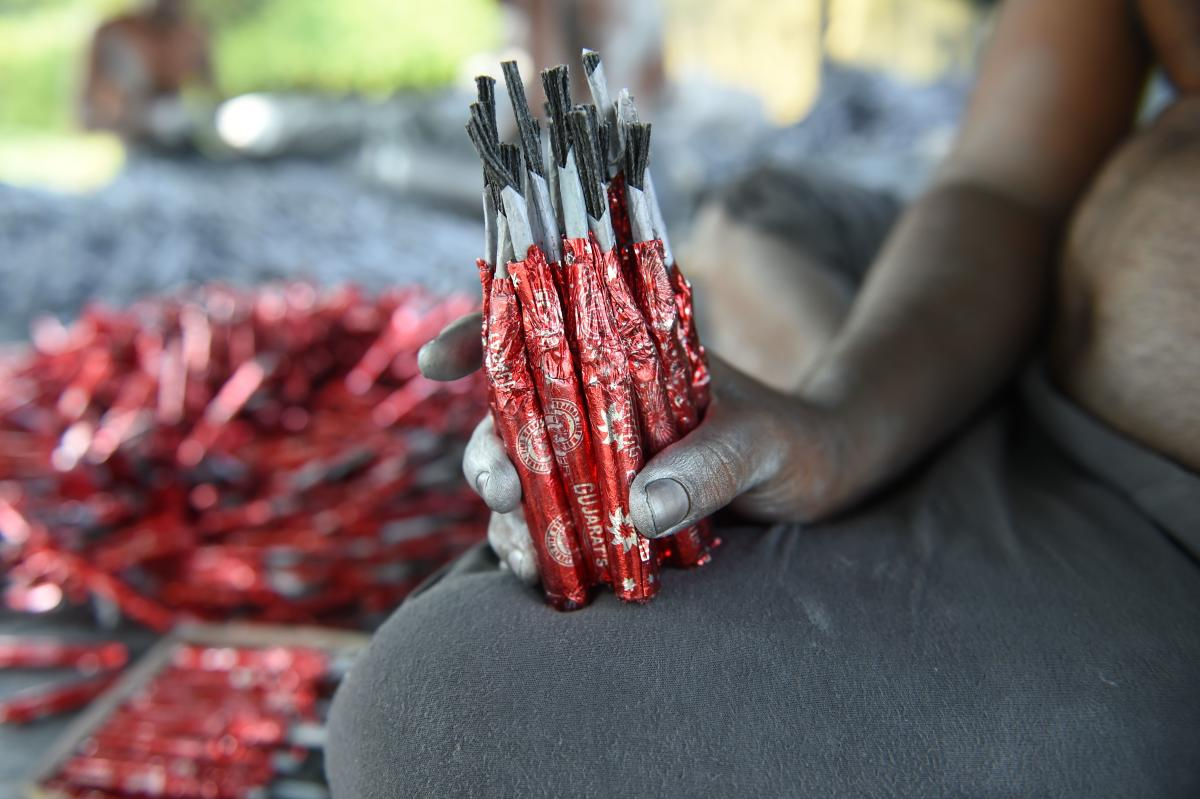 A worker prepares firecrackers at a workshop ahead of Diwali on the outskirts of Ahmedabad. AFP