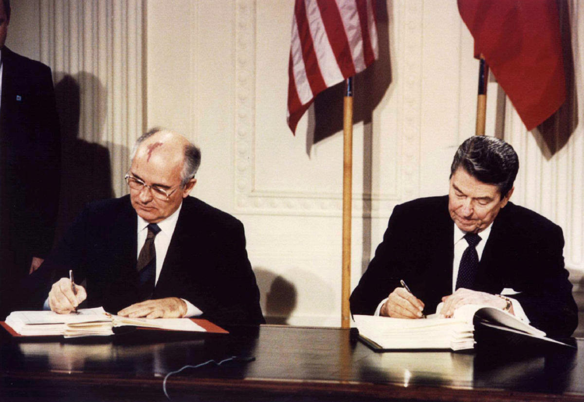 US President Ronald Reagan (R) and Soviet President Mikhail Gorbachev sign the Intermediate-Range Nuclear Forces (INF) treaty at the White House, Washington, on December 8 1987. REUTERS File Photo