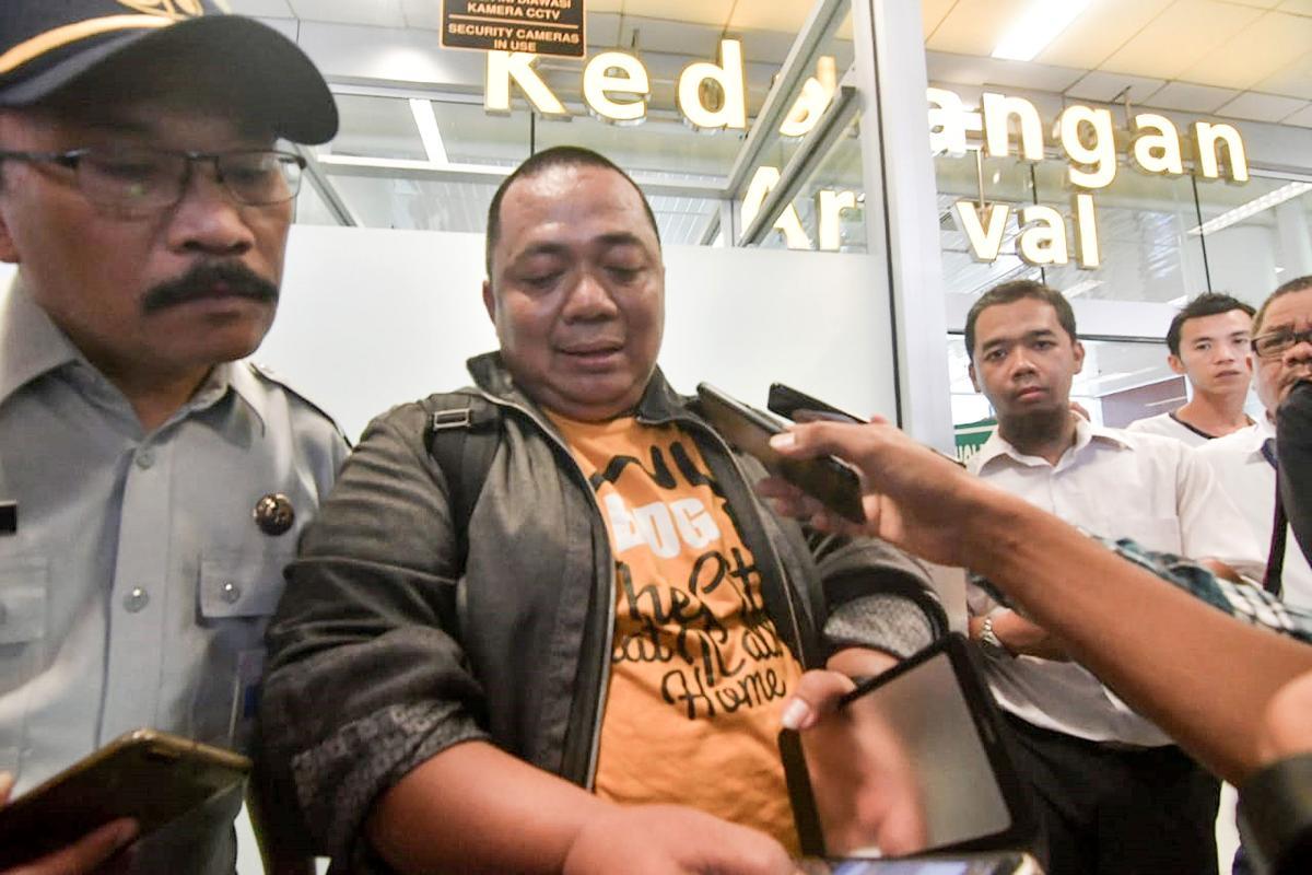 Sony Setiawan (C) speaks to journalists at Pangkal Pinang airport in Bangka Belitung province. AFP photo